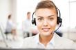 helpline operator with headphones in call centre