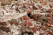 A pile of old broken red bricks