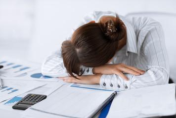 tired woman sleeping at work