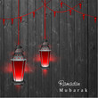 Hanging illuminated Arabic lamps on wooden background for Ramada