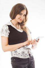 Woman standing while using a touchpad