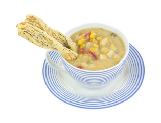 Chowder with twisted crackers in cup