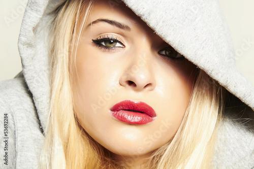 beautiful blond woman in hood. red lips