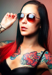 glamorous girl with tattoos.