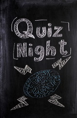 Quiz Night announcement on a Blackboard