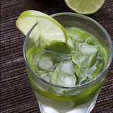 Mojito   with crushed ice and lime on a wicker tablecloth
