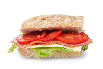big sandwich with salami cheese and tomato