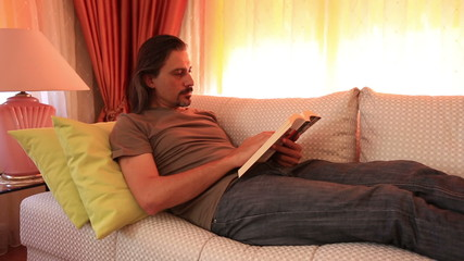 man reading book and turning page