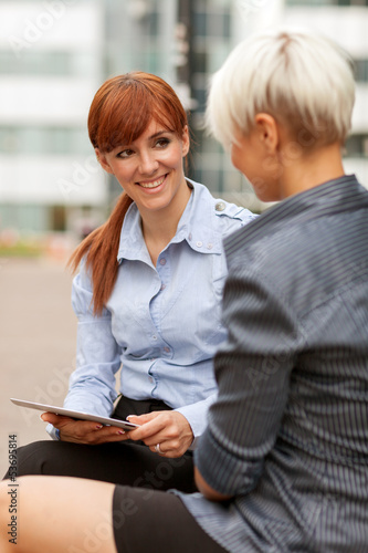 Two Businesswoman are having a conversation