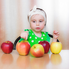 Happy Kid with apples.