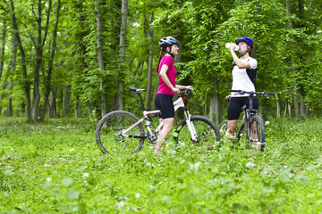 girls  biking in the forest