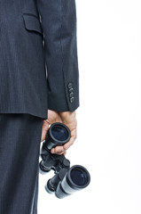 Businessman holding binocular concept of forecasting future