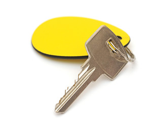 key with a tag on a white background