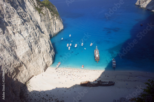 boats and people at shipwreck beach at Zakynthos island, Greece.