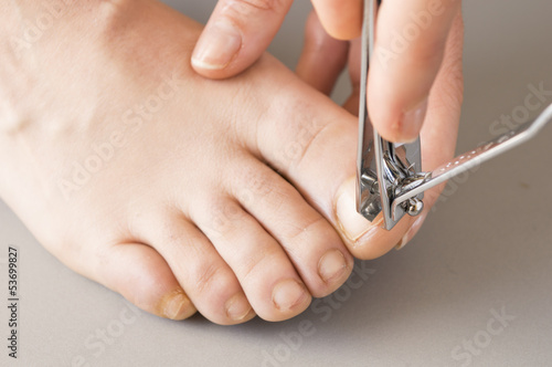 woman by becoming a pedicure