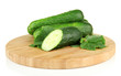 Tasty green cucumbers on wooden cutting board, isolated on