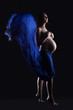Soulful pregnant woman posing in blue cloth