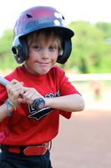 Happy baseball boy in helmet up close.