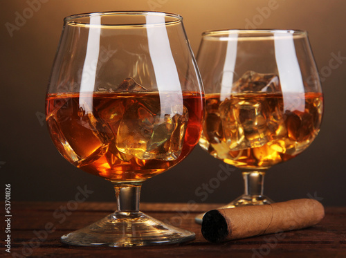 Brandy glasses with ice and cigar