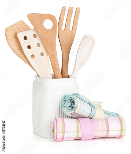 Kitchen utensils in holder and towels