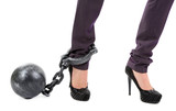 Business worker with ball and chain attached to foot isolated