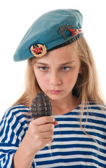 Portrait of the girl in the troop beret with a grenade in his ha