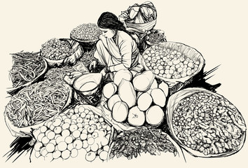 India - woman selling fruit and vegetable in a market