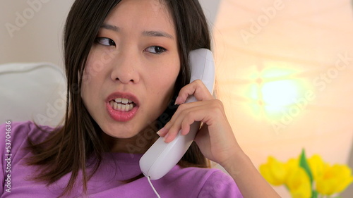 Close up of Chinese woman calling by phone