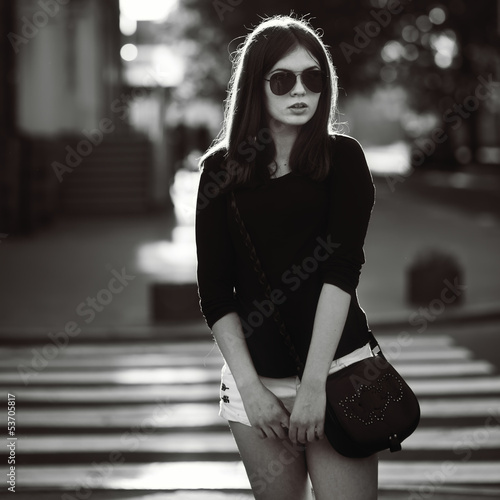 fashion portrait of a young dark hair girl