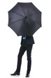 business man hides his face with umbrella