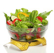 Healthy salad and a measuring tape isolated
