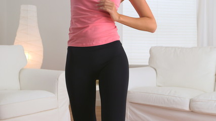 Graceful Chinese woman dancing in yoga pants