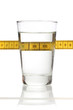 Glass of water and a measuring tape