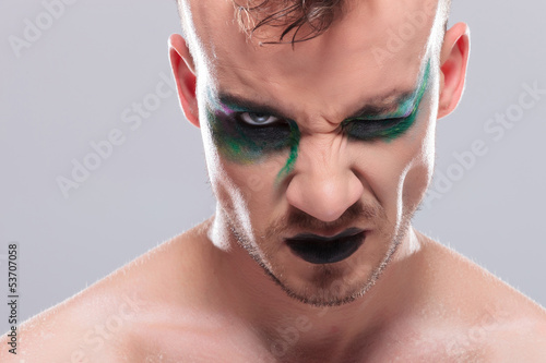 casual man with makeup and closed eye