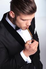 business man lighting his cigar up