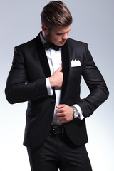 business man adjusting suit