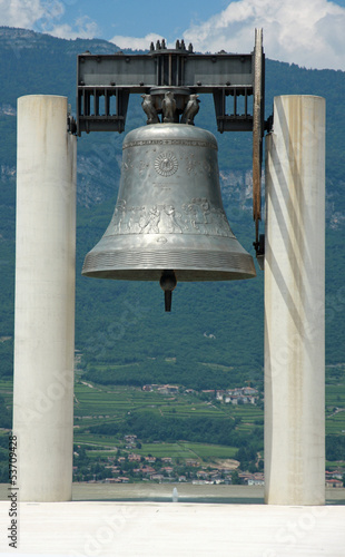 huge bronze Bell above the symbol of peace between peoples