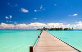 Fototapeta Most - Holzbrücke zum Strand einer einsamen Insel © Loocid GmbH