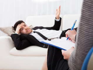 Business man talking to his psychiatrist explaining something