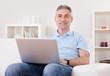 Mature Man Using Laptop