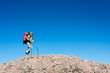 Hiker is standing on top of mountain in Crimea mountains against