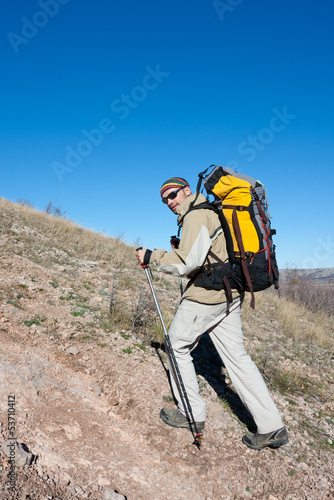 Hiker is climbing mountain in the Crimea mountains