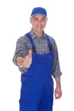 Mature Male Technician Making Thumbs Up Gesture
