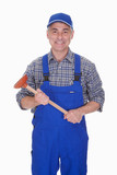 Portrait Of Male Plumber Holding Plunger