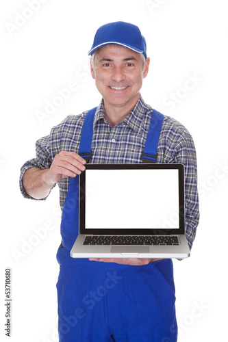 Mature Male Technician Showing Laptop