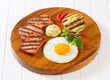 Grilled Leberkase with fried egg and mustard