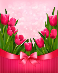 Holiday background with bouquet of pink flowers with bow and rib