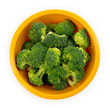 Chopped broccoli in a bowl isolated on white