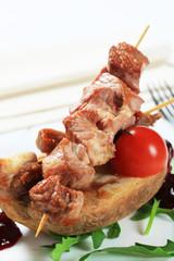 Pork kebabs and baked potato