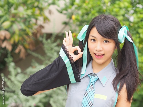 Pretty cosplay girl showing OK sign gesture